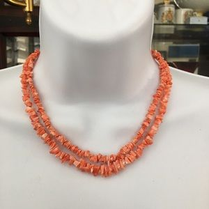 Two natural deep salmon coral chip necklaces
